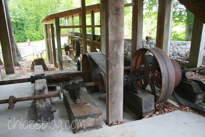 Old gears and pulleys of water powered grist mill